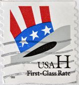 A stamp printed in USA shows Uncle Sam's Hat