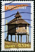 A stamp printed in France shows pigeon house