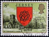 a stamp printed in Jersey shows Arms and St. Saviour´s Church