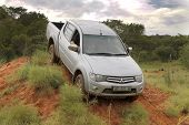 Silver Toyota Triton Dhd Crossing Obstacle
