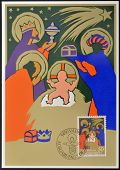 A stamp printed in Liechtenstein shows the magi at the Crib christmas