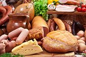 Variety of sausage products, cheese, eggs and vegetables. Close-up shot.