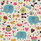 Cartoon blue elephants in flowers with butterflies. Seamless pattern can be used for wallpapers, pattern fills, web page backgrounds, surface textures. Gorgeous childish seamless background