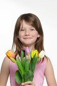 Beautiful Young Girl With A Bunch Of Tulips