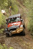 Crush Orange Jeep Rubicon Crossing Obstacle