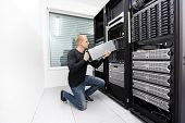 image of racks  - It engineer or consultant working with installation of a blade server in data rack - JPG