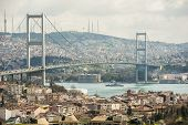 stock photo of suspension  - View of famous Bosphorus suspension bridge over river in Istanbul Turkey - JPG