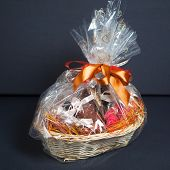 stock photo of gift basket  - gift basket against grey background - JPG