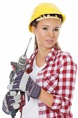 Young woman in protective helmet and jackhammer. Isolated on white.