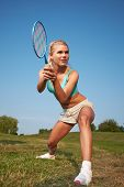 foto of badminton player  - badminton player in action  - JPG