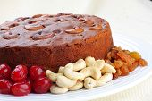 cake with red plums,resins and cashews