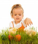Little Girl Reaching For The Eatser Eggs And Little Chickens