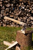 Wooden Block With Ax And Split Wood