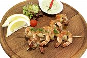 wooden plate with barbecue shrimp
