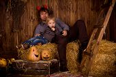 Father With Baby Son On Halloween Party