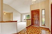 stock photo of linoleum  - Bright empty house interor with entrance hallway. Brown linoleum floor blend with wooden trim and wooden entance door