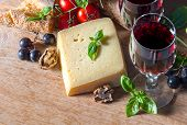 Cheese With Red Wine, Walnuts, And Grapes. Food Background