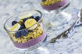 image of poi  - Hawaiian parfait with layers of poi granola blueberries bananas and drizzled with agave - JPG
