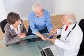 Senior Couple Discussing Over Medicine