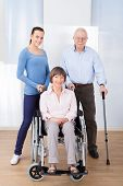 Caregiver With Disabled Senior Couple