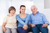 Happy Caregiver With Senior Couple