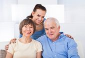 Happy Caregiver With Senior Couple