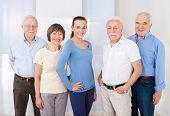 Confident Caregiver With Senior People