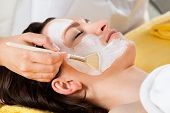 Therapist Applying Face Mask To Customer In Spa