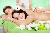 Woman Receiving Microdermabrasion Therapy At Beauty Spa