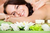 Woman Receiving Shoulder Massage At Beauty Spa