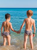 6-7 Years Boys In Front Of Sea Hand In Hand