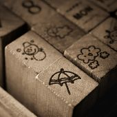 Wooden Rubber Stamps With Meteorology Symbol Icons.