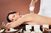 Woman Receiving Cupping Massage At Spa