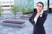 Beautiful Business Woman Talking By Phone On Street Against Office Building