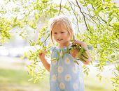 Portrait Of Happy Baby Girl In Foliage