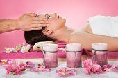 Woman Receiving Head Massage In Spa