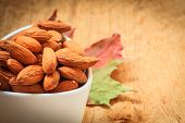 Almonds In Bowl On Wooden Background