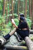 Girl Reading A Book In A Green Forest