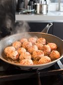 Meatballs Frying In The Frying Pan