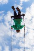 Young Boy Free As A Bird On A Swing