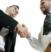 Two business men sharing a handshake