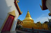 Golden Pagoda Architecture Of Northern Thailand In Temple Buddhism At Wat Phra That Hariphunchai, La