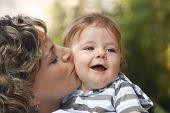 Baby boy enjoying moms affection