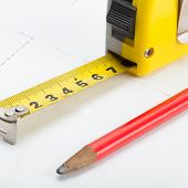 Tape Measure With Pencil Above Blueprint