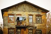Old Damaged House With Windows
