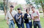 Asian Students Standing Happily In The University