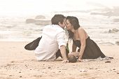Young beautiful couple flirting on beach