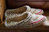 Belarus, Dudutki, A Souvenir Shop. Woven  Shoes From Straw