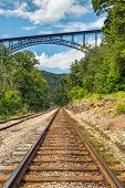picture of railroad car  - A rural railroad track points to one of the world - JPG