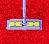 Vacuum Cleaner On Red Carpet